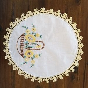 Vintage linen doily with hand embroidered accent